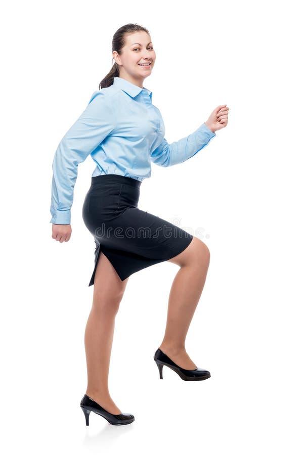 爬上事业梯子的妇女的画象 免版税库存图片
