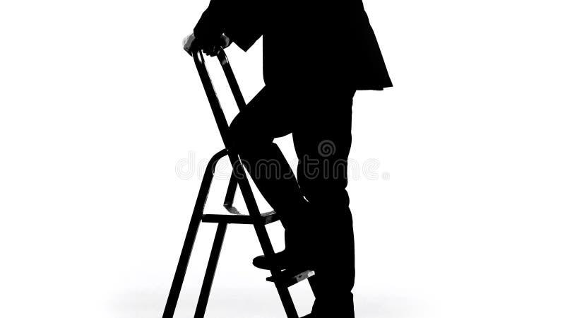 爬上事业梯子,奇特的局的政客剪影 免版税库存照片