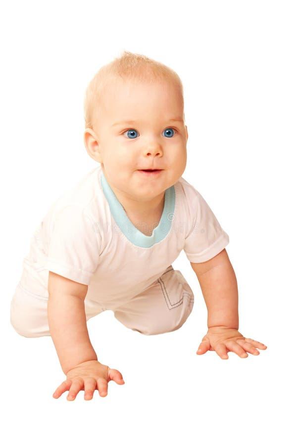 爬行愉快的婴孩。 库存照片