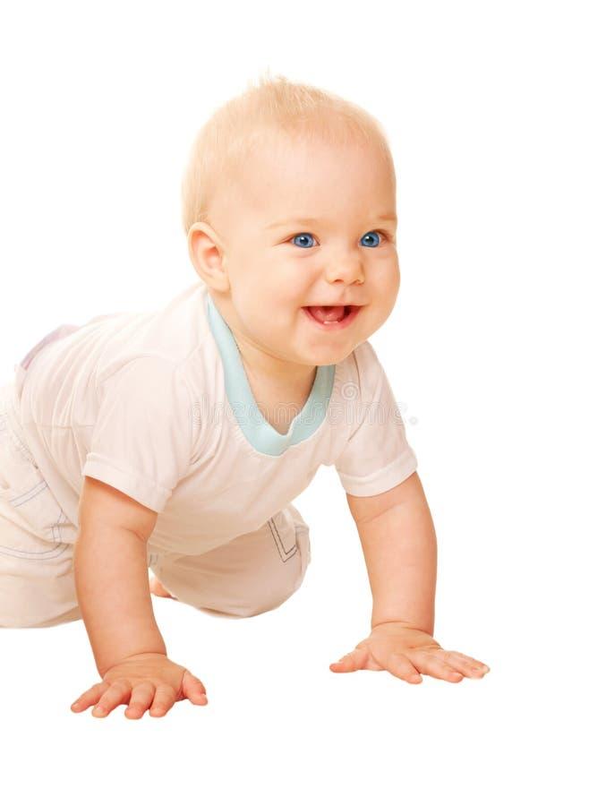 爬行愉快的婴孩。 免版税图库摄影