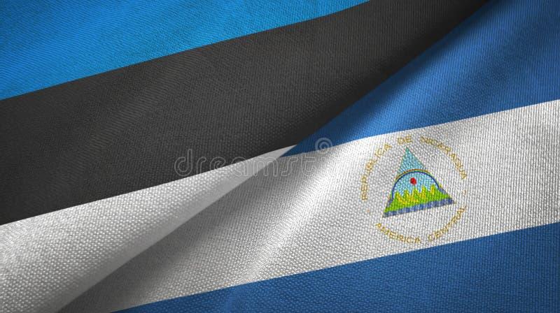 爱沙尼亚和尼加拉瓜两旗子纺织品布料,织品纹理 皇族释放例证