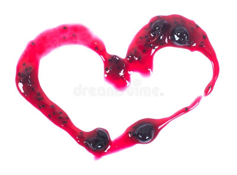 爱红色果酱以在白色背景隔绝的心脏的形式 库存照片