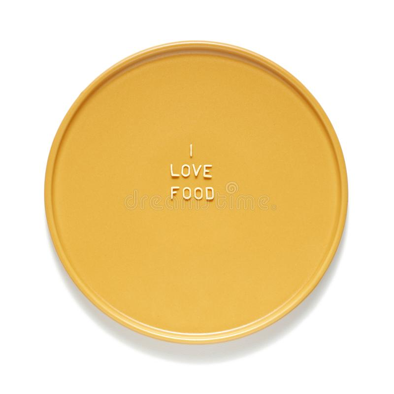 爱食物由通心面信件做了在黄色板材 r 免版税图库摄影
