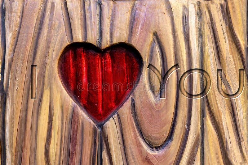 爱simbol在情人节 被雕刻的重点木头 免版税库存照片