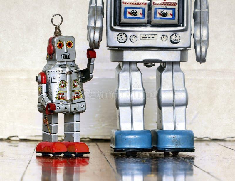 父亲和儿子机器人玩具 库存图片