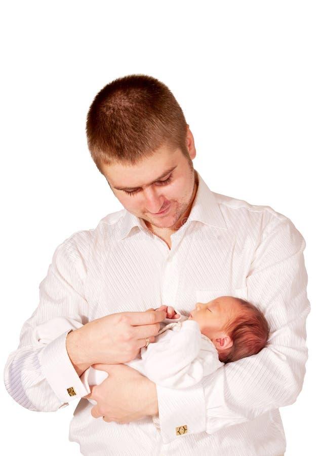 父亲和新出生的婴孩。 婴孩关心。 库存图片