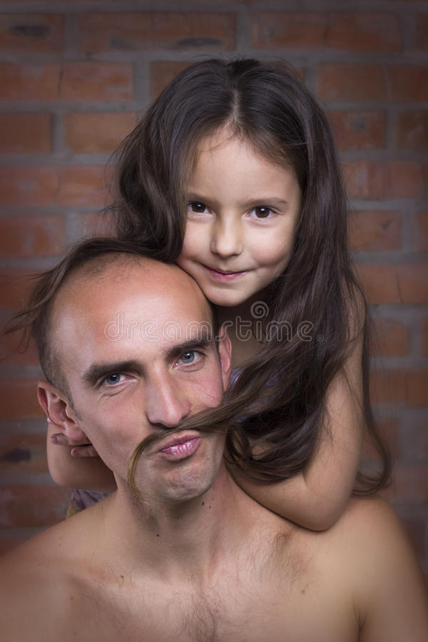爸爸和女儿 免版税图库摄影