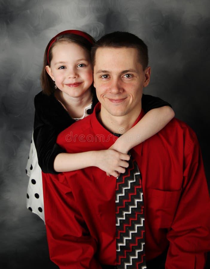 爸爸女儿她拥抱 图库摄影