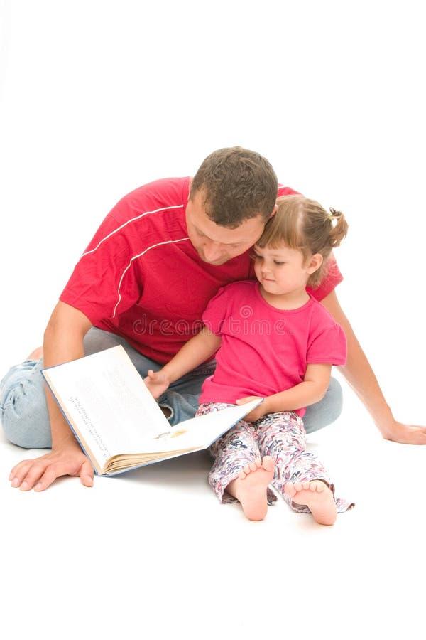 爸爸读取 免版税库存照片