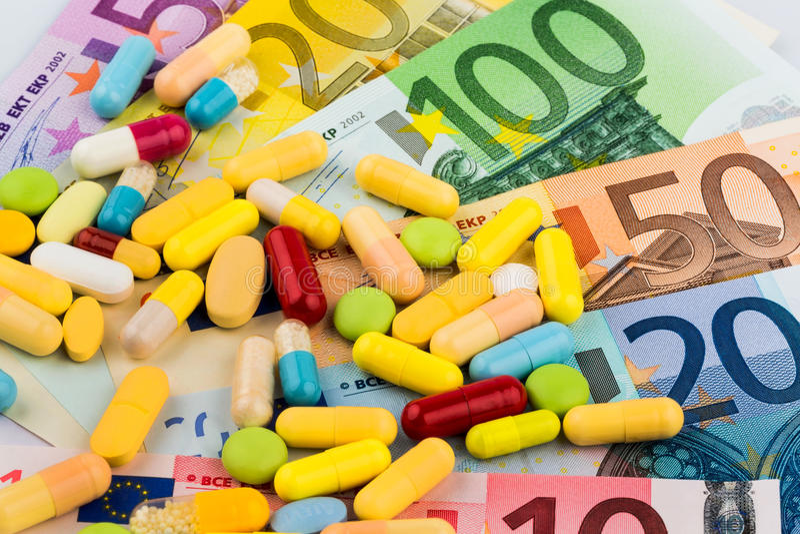 片剂和一百欧元票据 免版税库存照片
