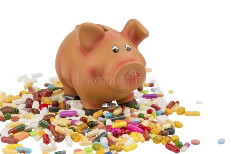 片剂和存钱罐 免版税库存照片