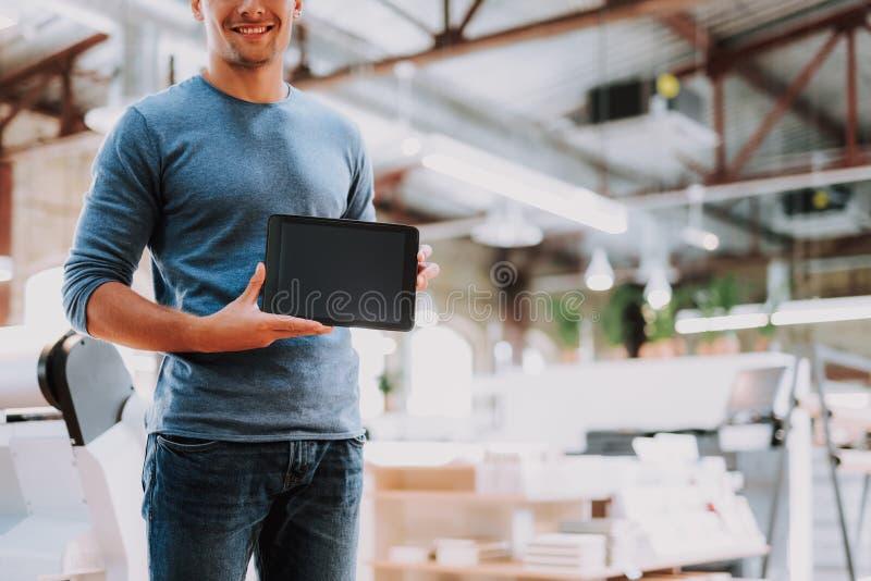 片剂计算机是生活的改善的优秀设备 免版税库存照片
