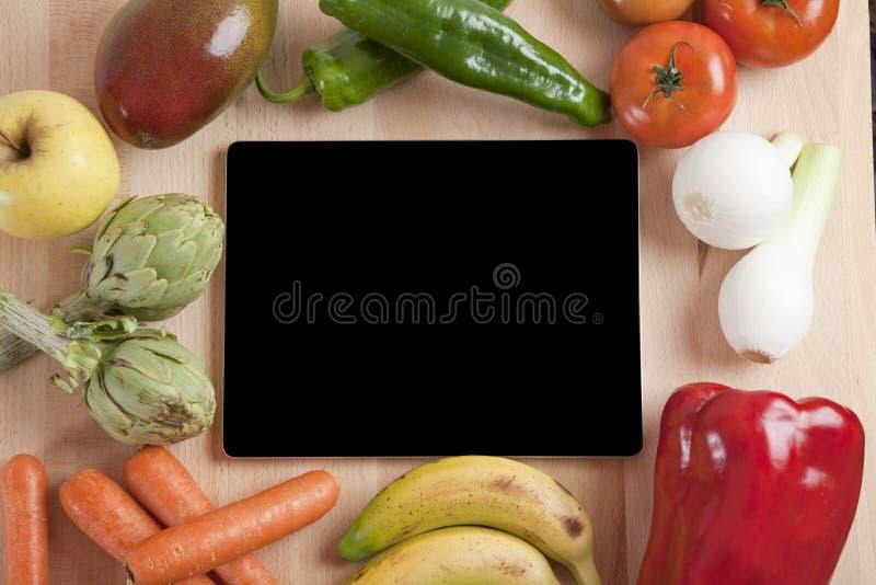 片剂水果和蔬菜 库存图片