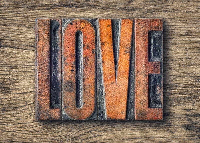 活版木类型打印块-爱 免版税库存图片
