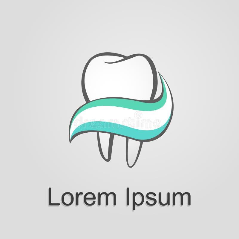 牙和牙膏在灰色背景 免版税库存图片