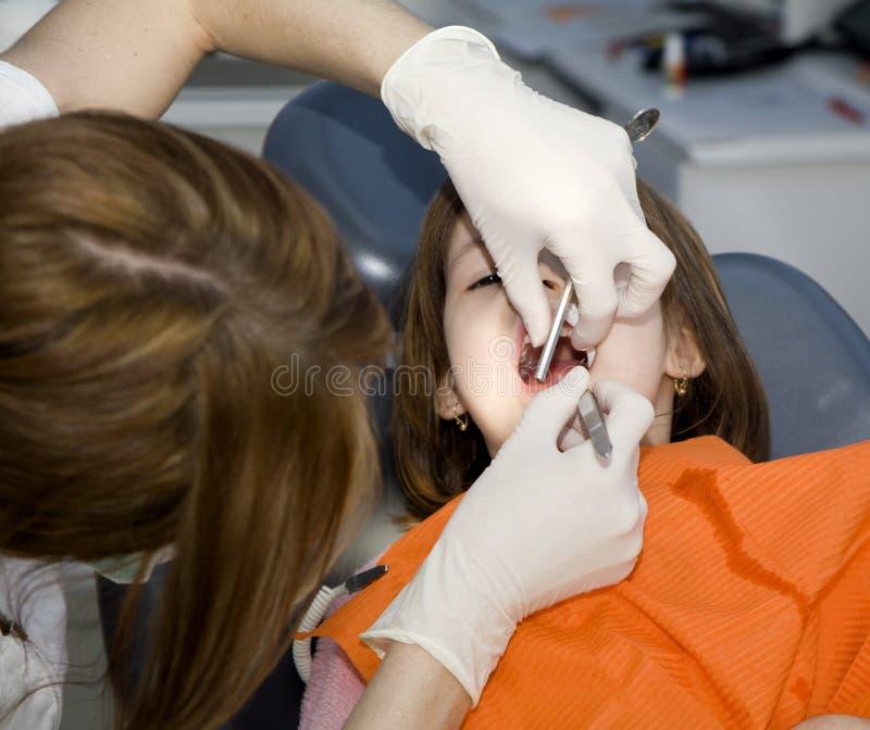 牙科医生女孩一点 图库摄影