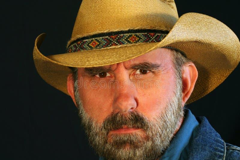 牛仔半眯着的眼睛 图库摄影