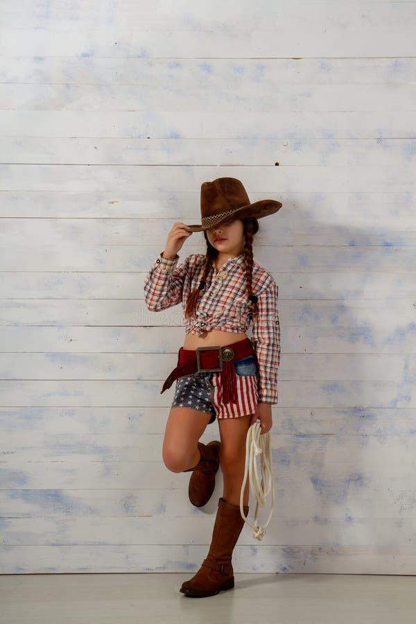 牛仔女孩一点 免版税图库摄影