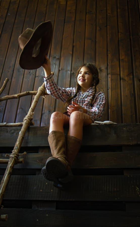 牛仔女孩一点 图库摄影