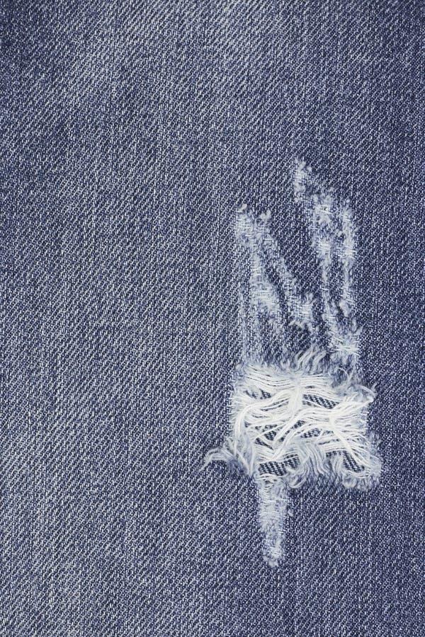 牛仔布剥去了蓝色牛仔裤纹理 抽象背景褪色牛仔裤 r 免版税库存图片