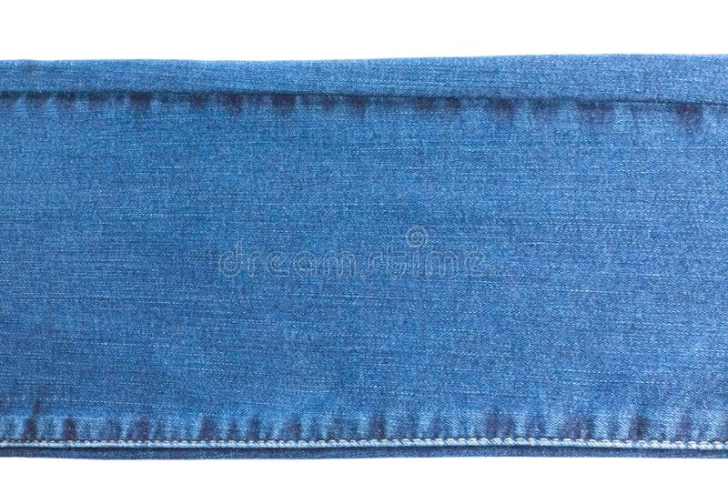 牛仔布和牛仔裤背景,一部分的有缝的牛仔裤,长,被隔绝 图库摄影