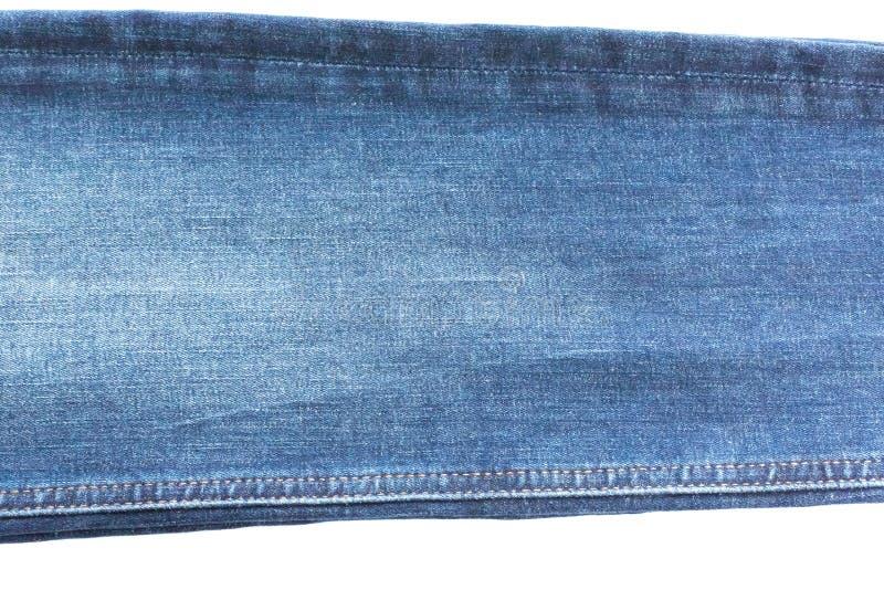 牛仔布和牛仔裤背景,一部分的有缝的牛仔裤,长,被隔绝 库存照片