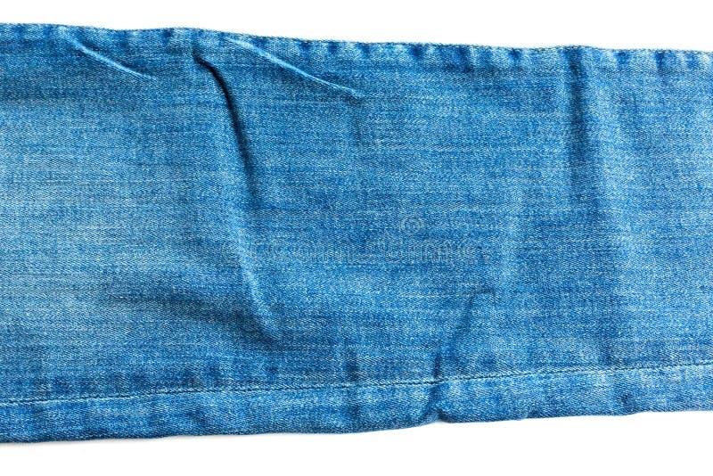 牛仔布和牛仔裤背景,一部分的有缝的牛仔裤,长,被隔绝 免版税库存图片