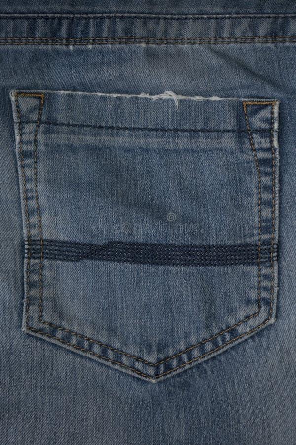 牛仔布纹理背景、破旧的牛仔裤和牛仔布口袋 库存照片