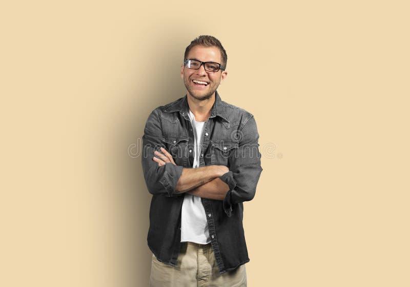 牛仔布衬衣的年轻人 免版税图库摄影