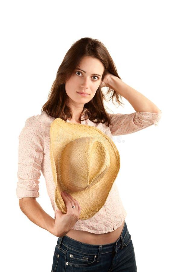 牛仔帽俏丽的妇女 免版税库存照片