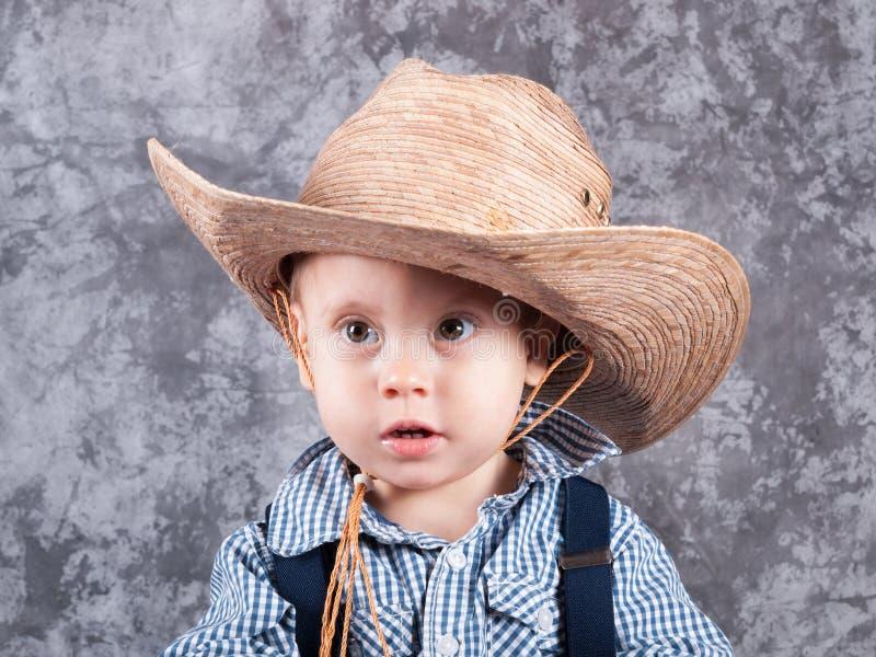 牛仔帽的小孩 库存图片
