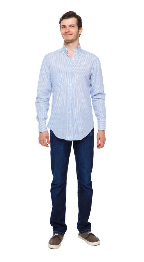 牛仔裤男人的前景 站立的年轻人 免版税图库摄影