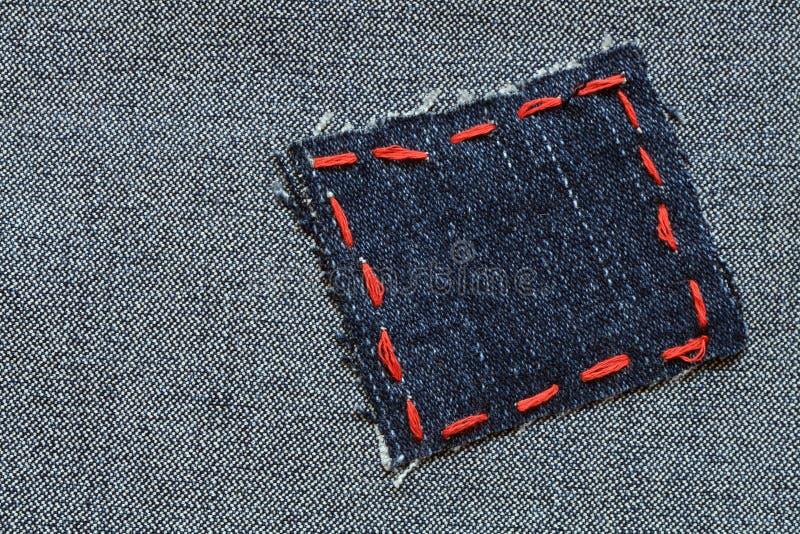 牛仔裤补丁程序 库存照片