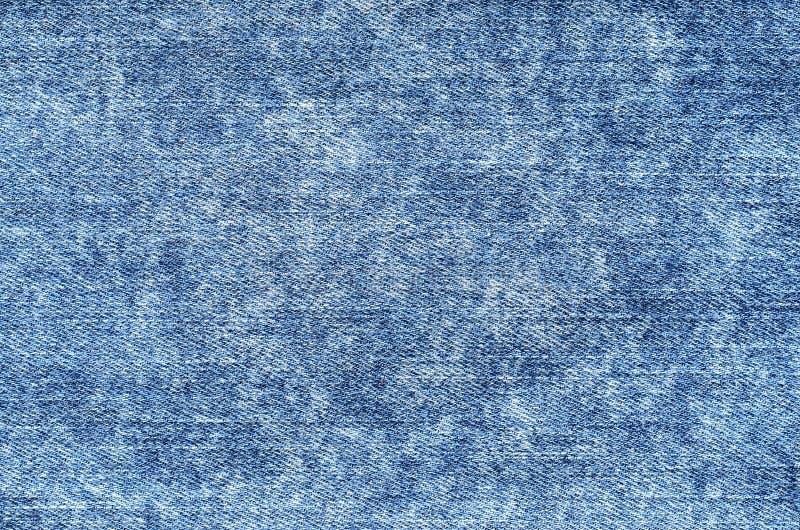 牛仔裤酸冲洗蓝色 牛仔布背景,纹理,关闭 Fa 免版税库存图片