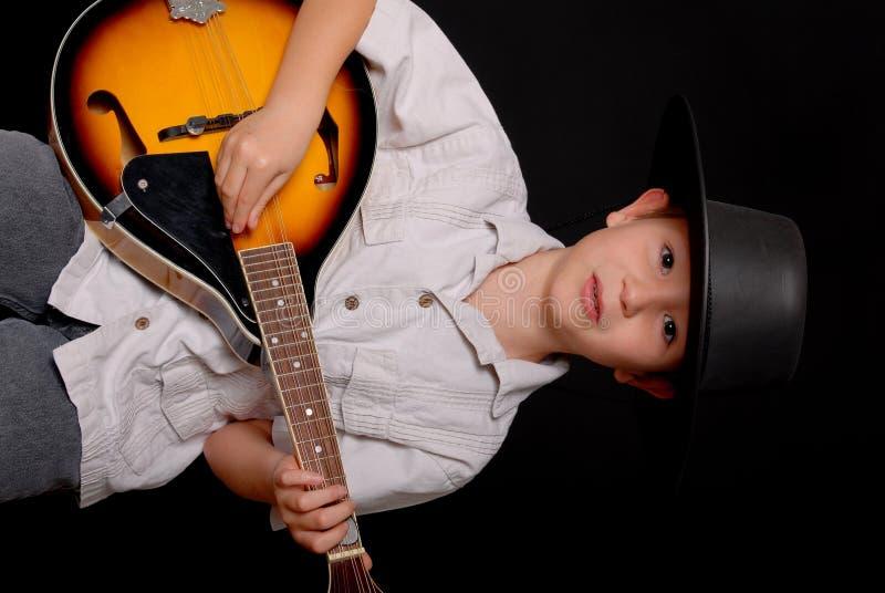 牛仔音乐家年轻人 免版税库存图片