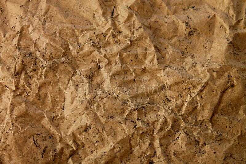 牛皮纸被弄皱的棕色背景纹理  库存照片
