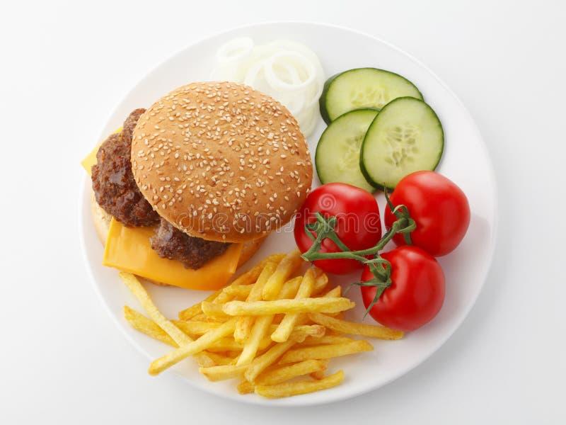 牛肉乳酪汉堡包用炸薯条 免版税库存图片