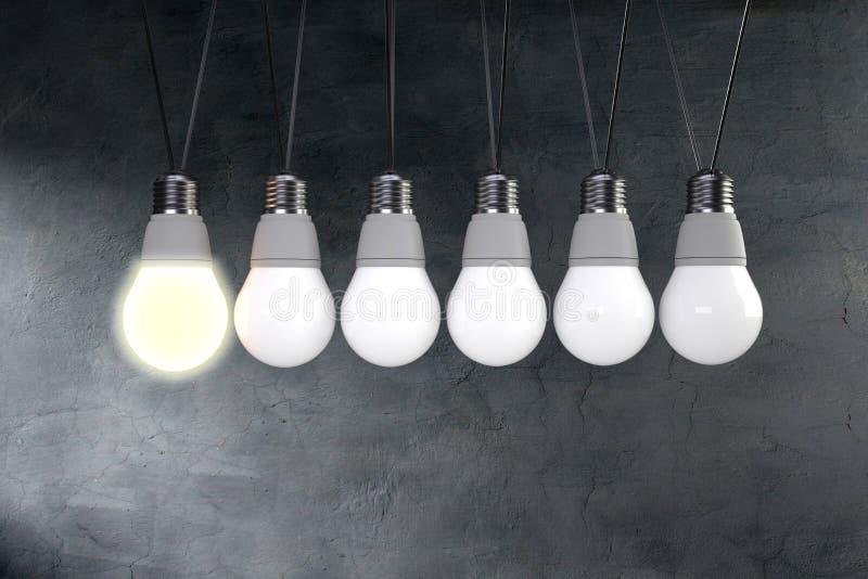 牛顿的与电灯泡的摇篮概念 免版税库存图片