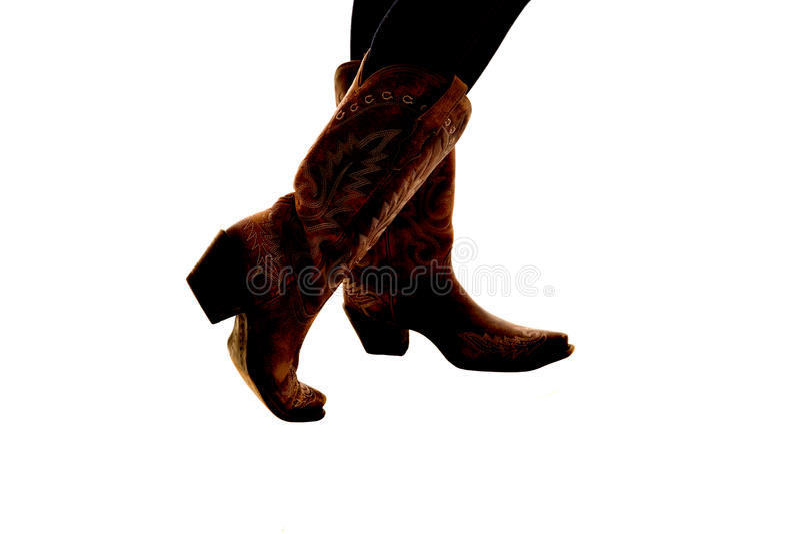 牛仔靴半剪影在白色背景的 库存图片