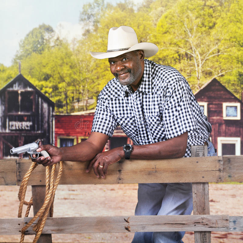 牛仔的得到枪 免版税库存照片