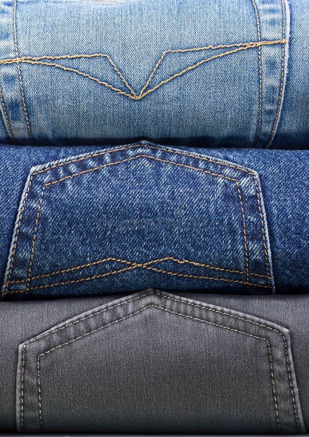 牛仔裤堆积多种 图库摄影
