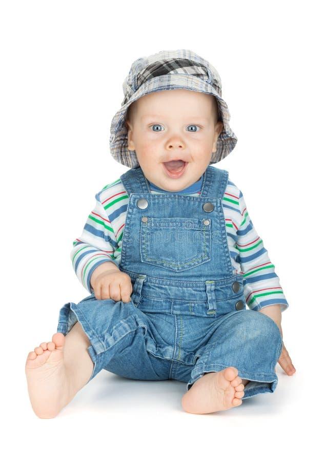 牛仔裤的小逗人喜爱的男婴 免版税库存图片