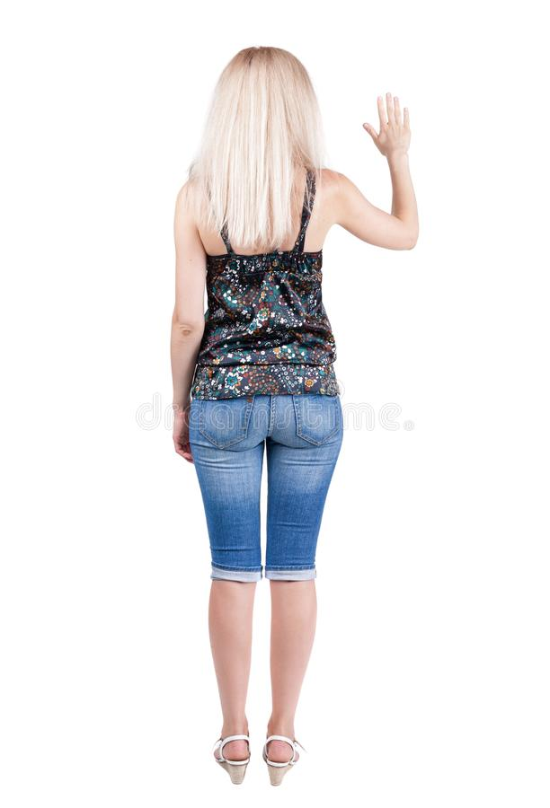 牛仔裤的少妇在某事按 库存照片