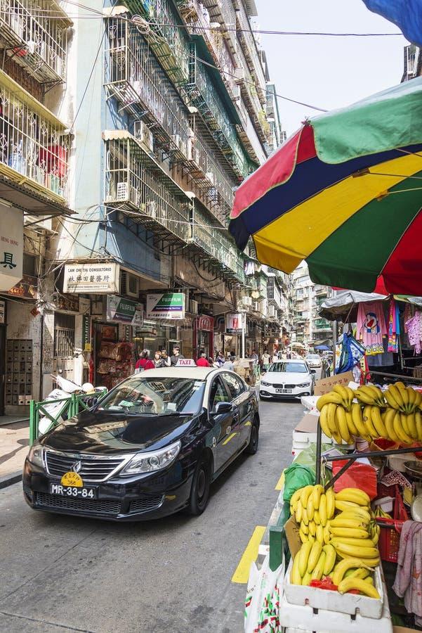 购物农贸市场和出租汽车在澳门瓷 库存照片