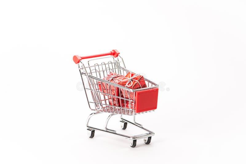 购物的小型运车与礼物 库存图片