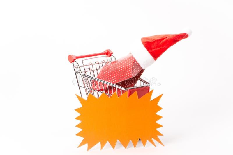 购物的小型运车与礼物 免版税库存照片