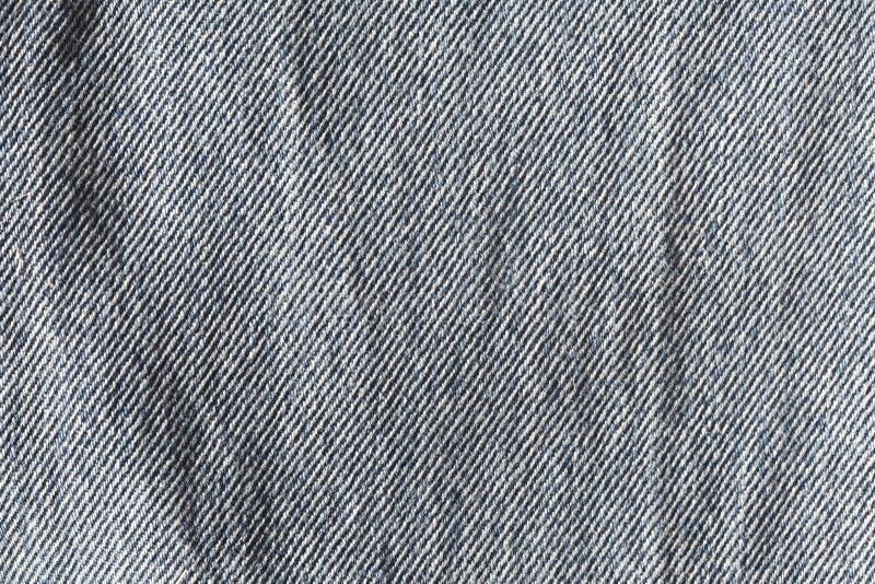 物质的蓝色牛仔裤 免版税库存照片