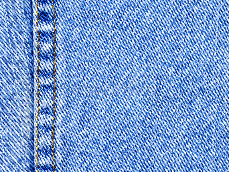 物质蓝色牛仔布的牛仔裤 图库摄影
