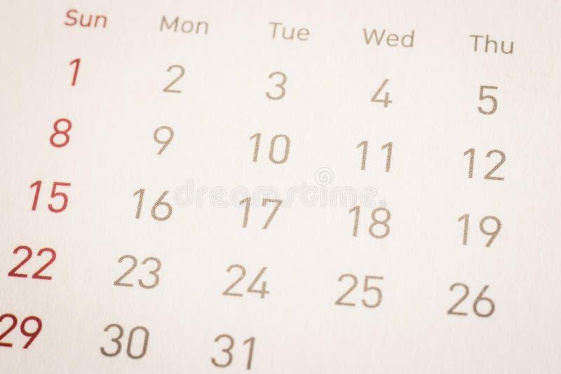 特写镜头在日历页,葡萄酒样式约会 免版税库存照片