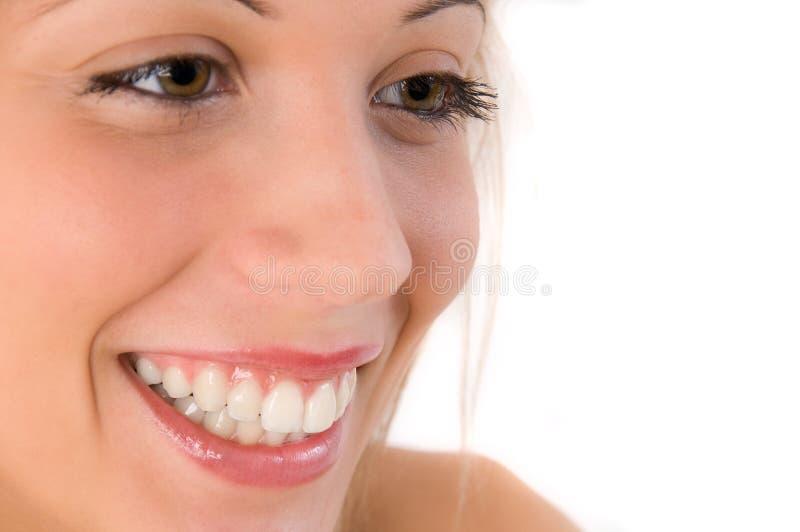 特写镜头微笑的妇女 免版税库存图片